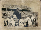 Ara Parseghian Lifted Up by Players