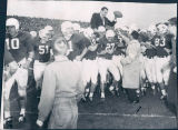 Ara Parseghian Lifted Up by His Team