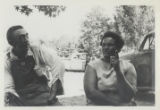 Photograph, Two Mississippi residents in discussion