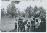 Photograph, Carole Gross with children in field in Mississippi